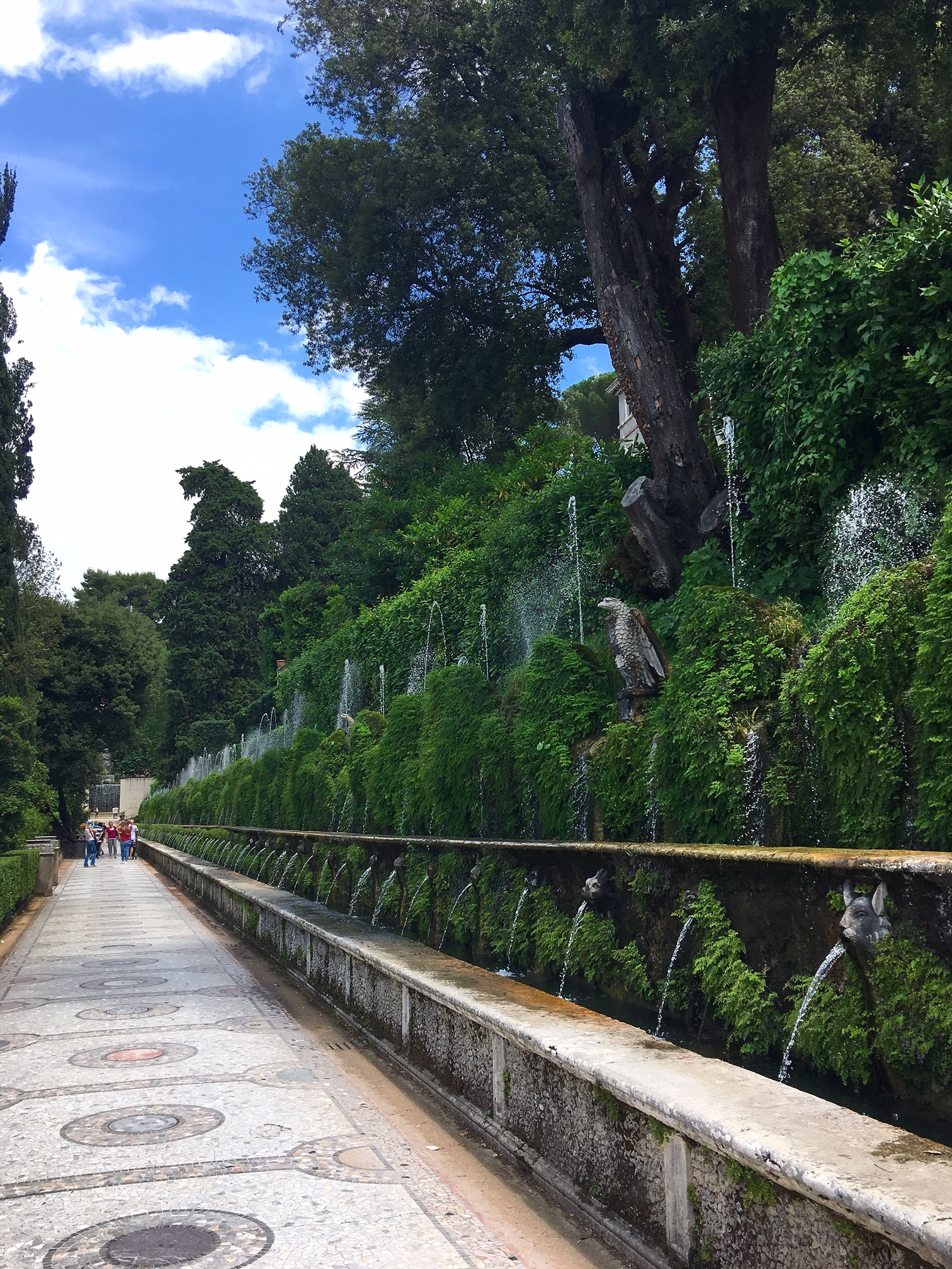 The incredible fountains at Villa D'Este in Tivoli. Villa d'Este is one of the best day trips from Rome, read on to find out about 9 other day trips from Rome that are accessible by train.