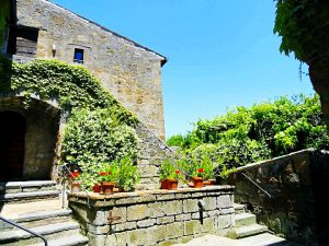 Civita di Bagnoregio is Italy's most spectacular hilltop town, and most people have never heard of it! Known as the Dying City, Civita is slowly eroding and falling down the mountain from the high peak it teeters on top of. It is like an island in the sky. You need to know about Civita and add it to your Italian itinerary. Read on to find out why