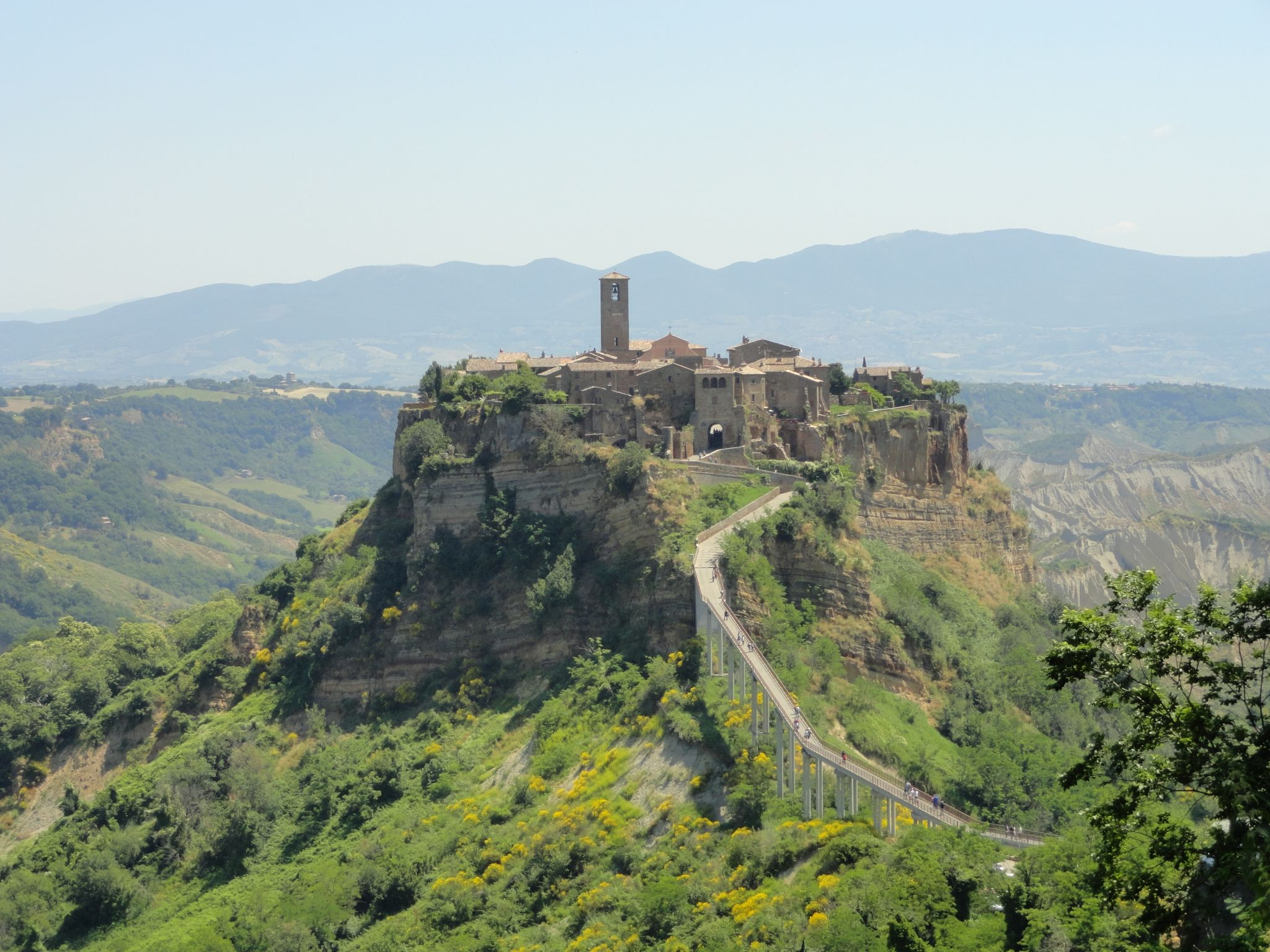 Civita di Bagnoregio is a wonderful day trip to take from Rome. Known as the dying city , it is slowly eroding and falling down the mountain. Learn more about Civita as well as 9 other day trips from Rome by train here