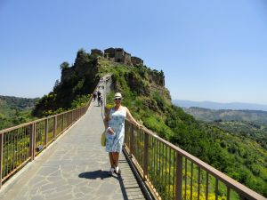 Civita di Bagnoregio, the dying city, is a fabulous day trip from Rome. Learn all about Civita as well as 9 other of the best day trips from Rome by train in this post