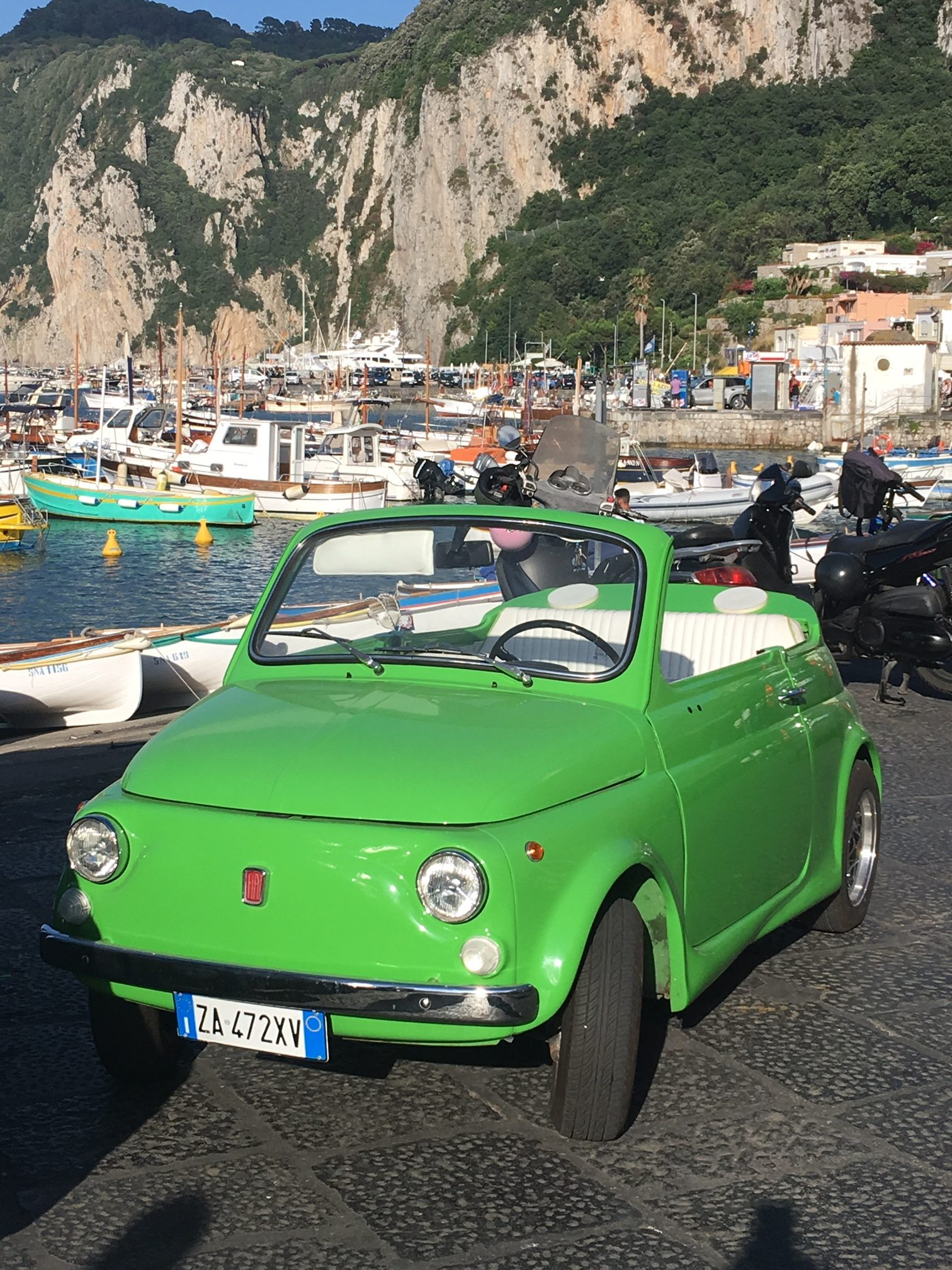Green Fiat 500 in Capri. Learn how to get the best deals on airline tickets. If you could fly anywhere in the world, where would you go?