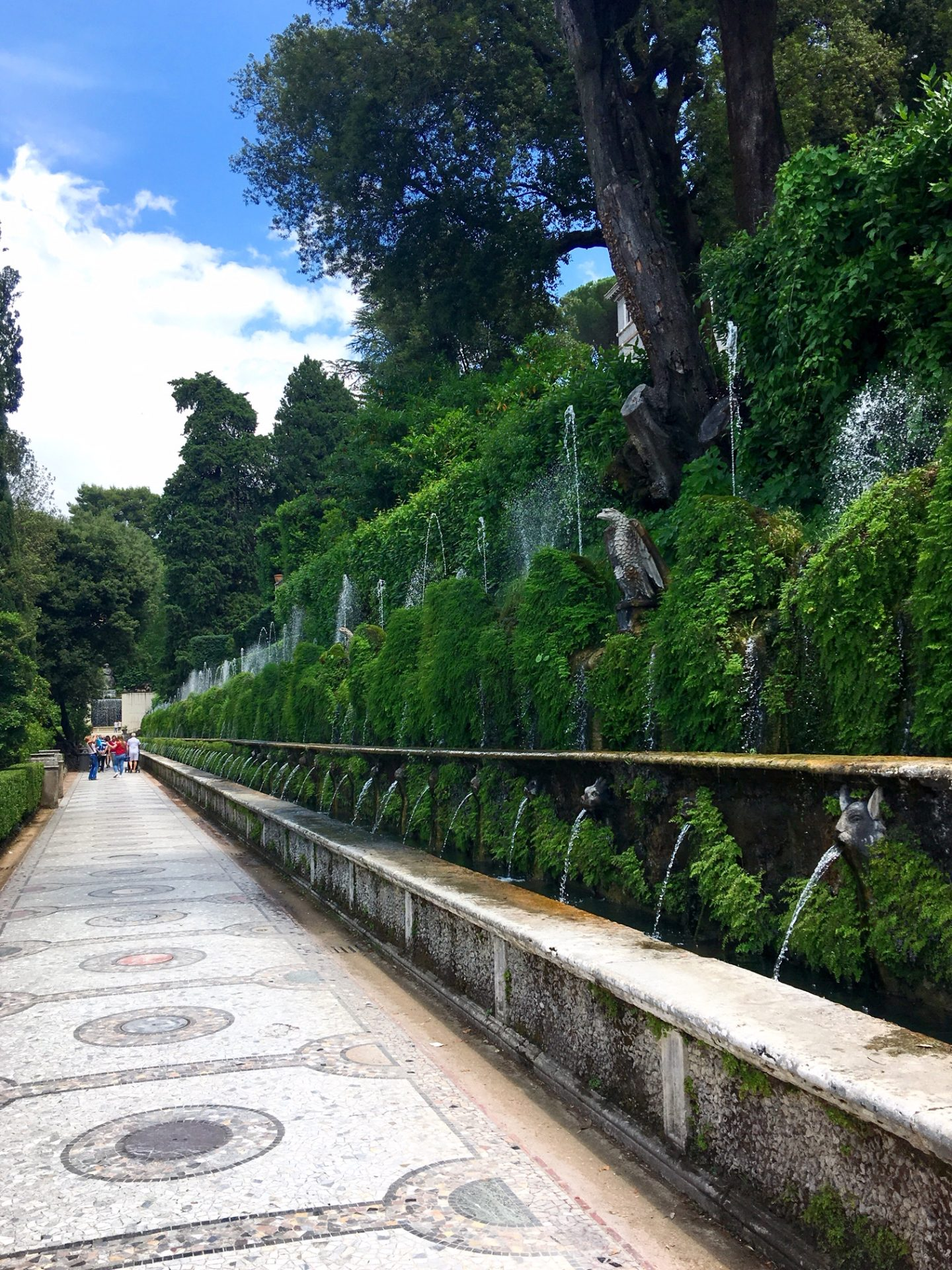 walkways lined with gargoyle fountains in the gardens at Villa d'Este in Tivoli
