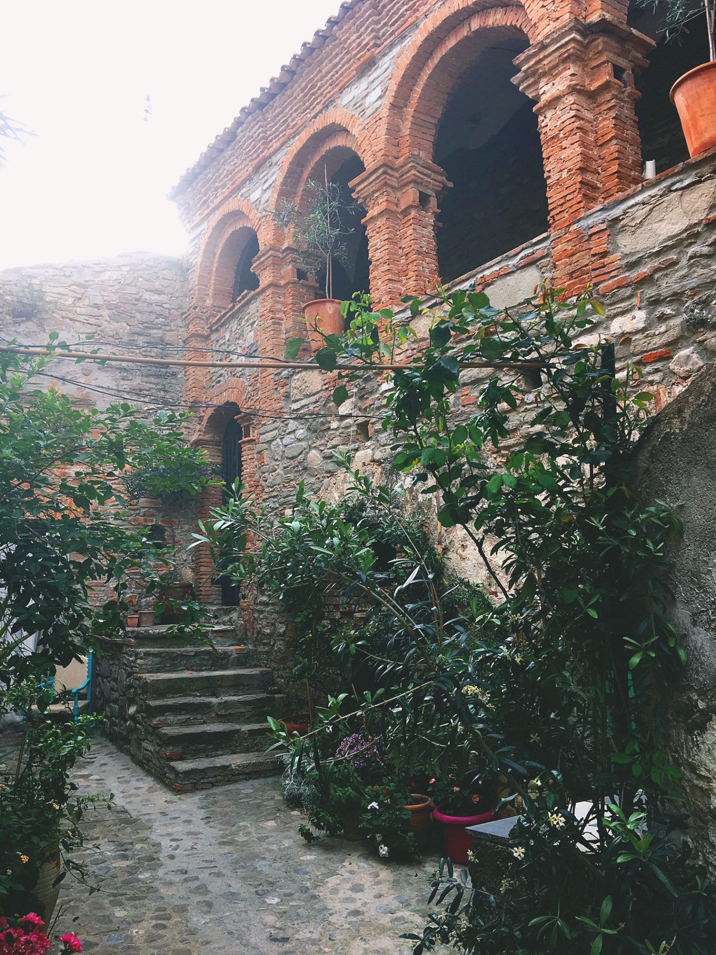 the courtyard and arab arches at the Mandarin, Orangery Retreat in Basilicata