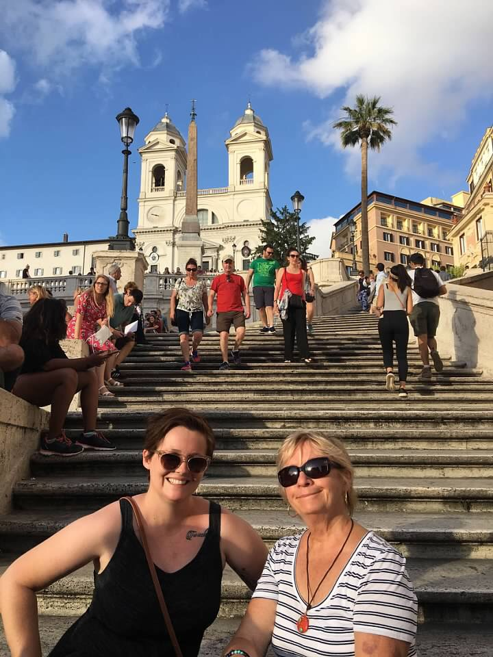 travelers sitting on the iconic Spanish Steps in Rome. New laws now make this illegal, with fines up to 450 euros