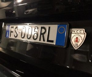 NCC Shield next to rear license plat on prefessional vehicle in Italy