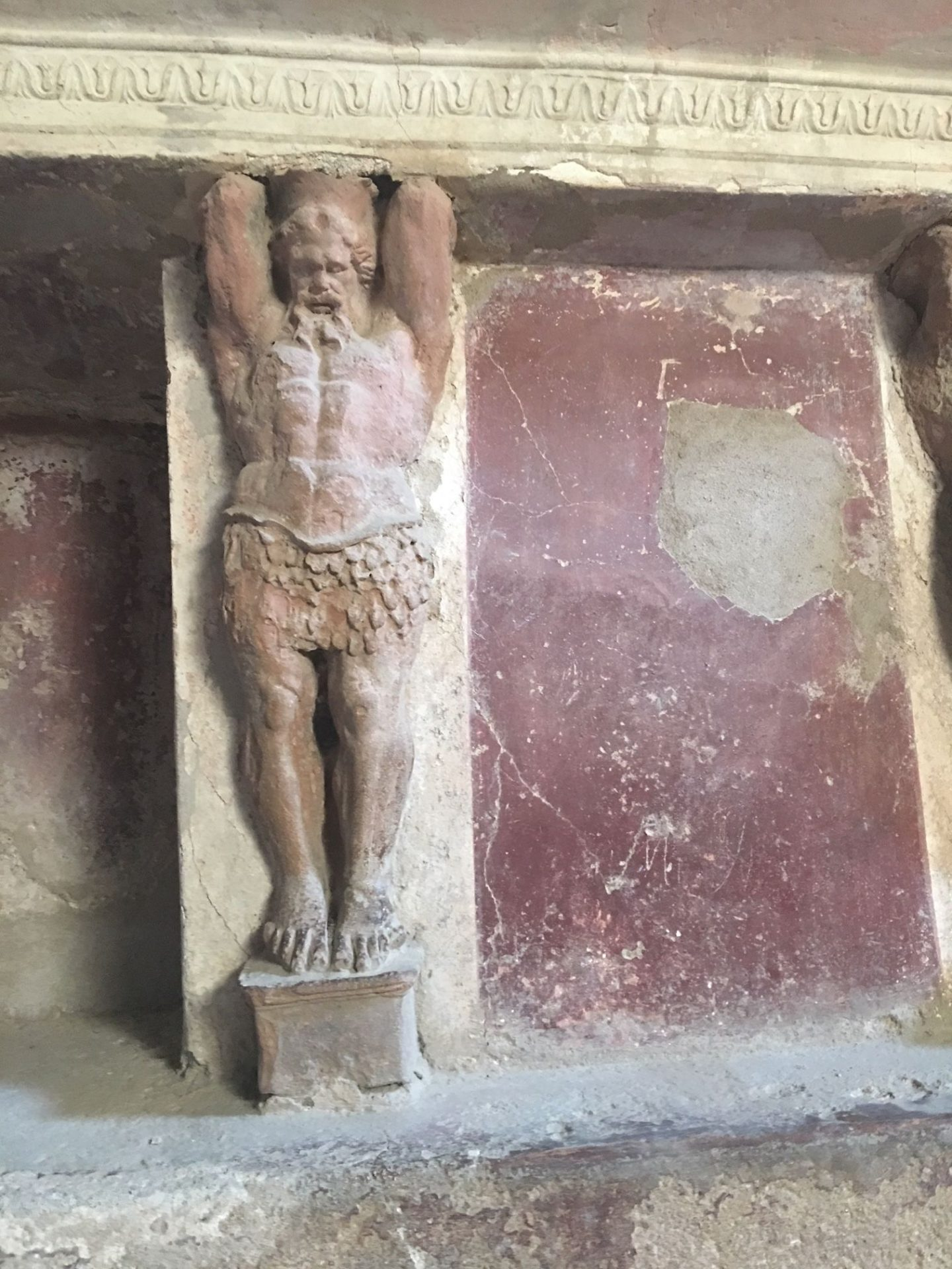 statue in bathhouse in Pompeii