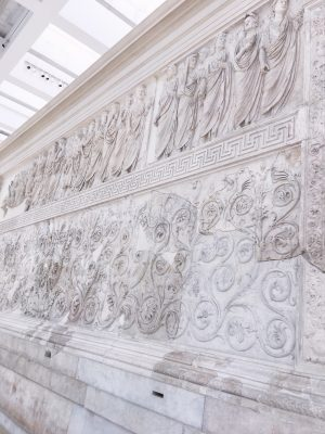 Carvings on the exterior of Ara Pacis in Rome