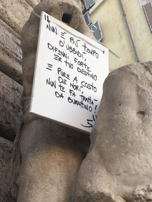 Pasquino the Talking Statue of Rome with romanesco sign